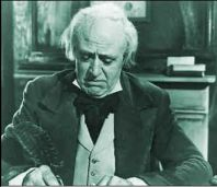 Alastair Sim as Ebenezer Scrooge
